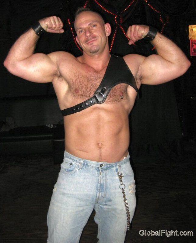 leather daddie flexing biceps