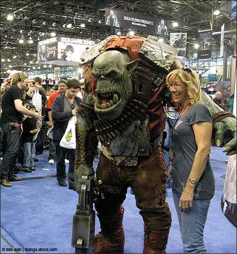 Video Game Cosplay | An Ork from Warhammer 40,000 poses with a NYCC attendee.