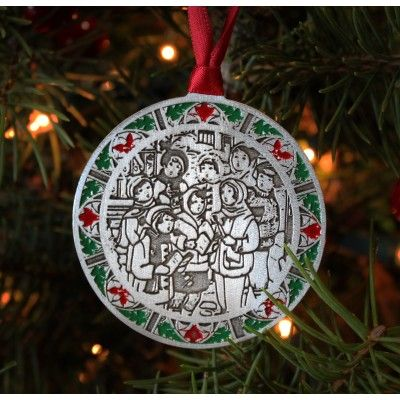 Christmas carols are sure to elicit happy holiday memories at any time of the year. Get into the holiday spirit with this ornament that features carolers and a hand painted stained glass style border.