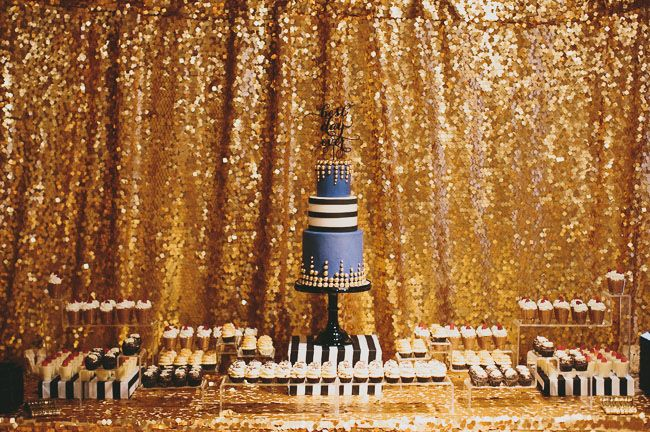 gold. glitter. feathers. so over the top. but very beautiful. this is the type of wedding my mother would love.