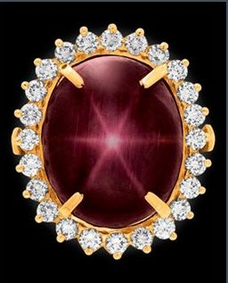 """The 27.62 """"Star of Bharany"""" Ruby has a rare combination of purplish-red color with a fairly distinct 6-rayed star. It is set in an 18k gold an diamond ring."""