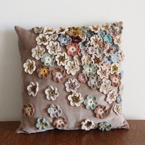 crochet flowers on a cushion - excellent idea for making a plain cushion very pretty