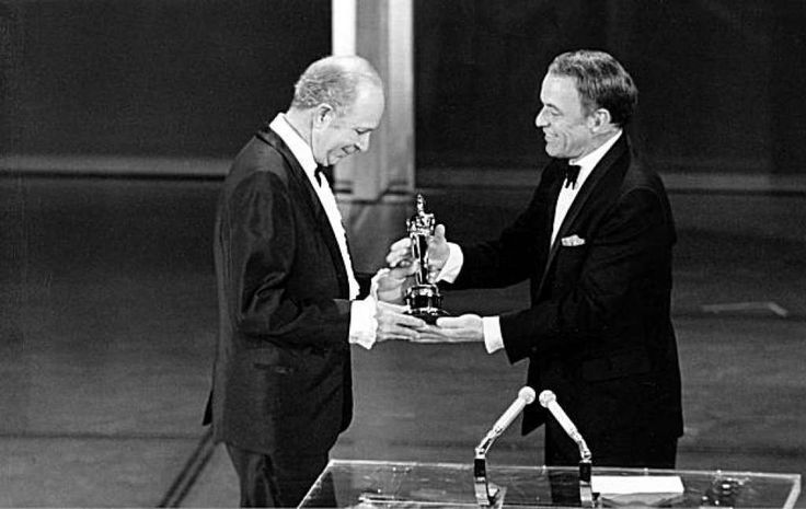 """Frank Sinatra presents an Oscar to Jack Albertson at the Academy Awards ceremony at the Music Center in Los Angeles, Ca., April 14, 1969.  Albertson was named best supporting actor for his role in the movie """"The Subject Was Roses.""""  (AP Photo)"""