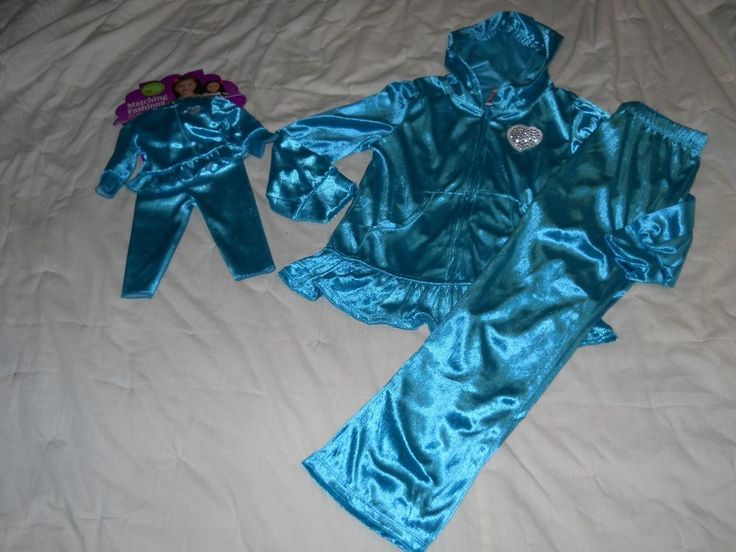 """We have up for sale a Dollie and Me hoodie outfit and includes a girls outfit and matching doll outfit that are new. These outfits are a blue sparkle in color, long sleeves, full front zipper, a hood, blue pants, and a matching doll outfit that fits most 18"""" dolls.   eBay!"""