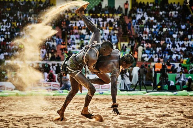 Sports, 2nd prize stories. BB Bisma Ndoye defeats the wrestler Maraka Dji in the Demba Diop stadium in Dakar, Sierra Leone, April 5, 2015.