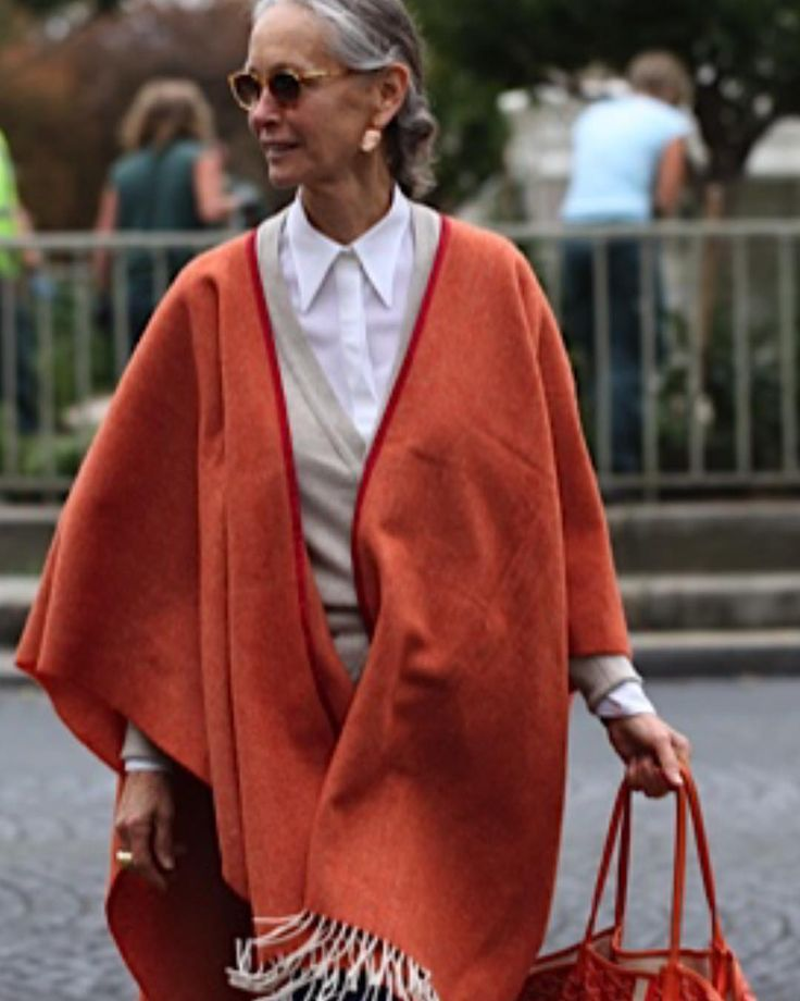 Basic Beige always has a place in My wardrobe. Stole this oatmeal colored cashmere cardie from My men's collection. My vintage Cameo earrings were a find in an Off street in Florence. My orange poncho? A sample I had made for My boutique and decided it was a little Off!!! Did not produce it!!! Am I a little Off? #goyardbag #CrimsonCashmere white shirt.