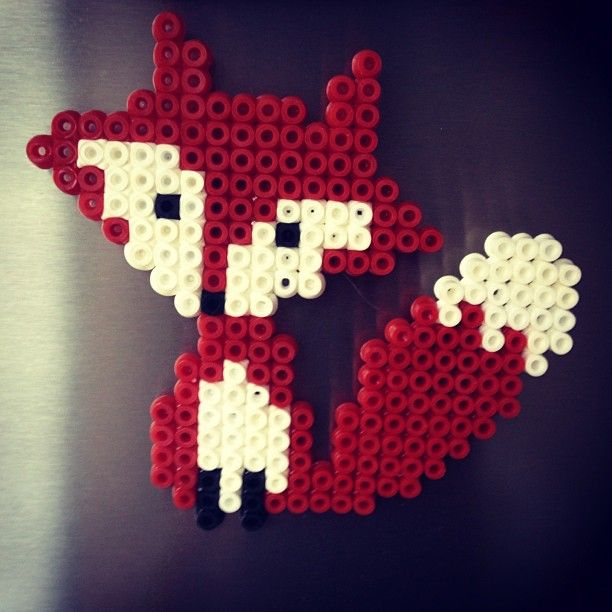 Red fox made out of fuse beads.