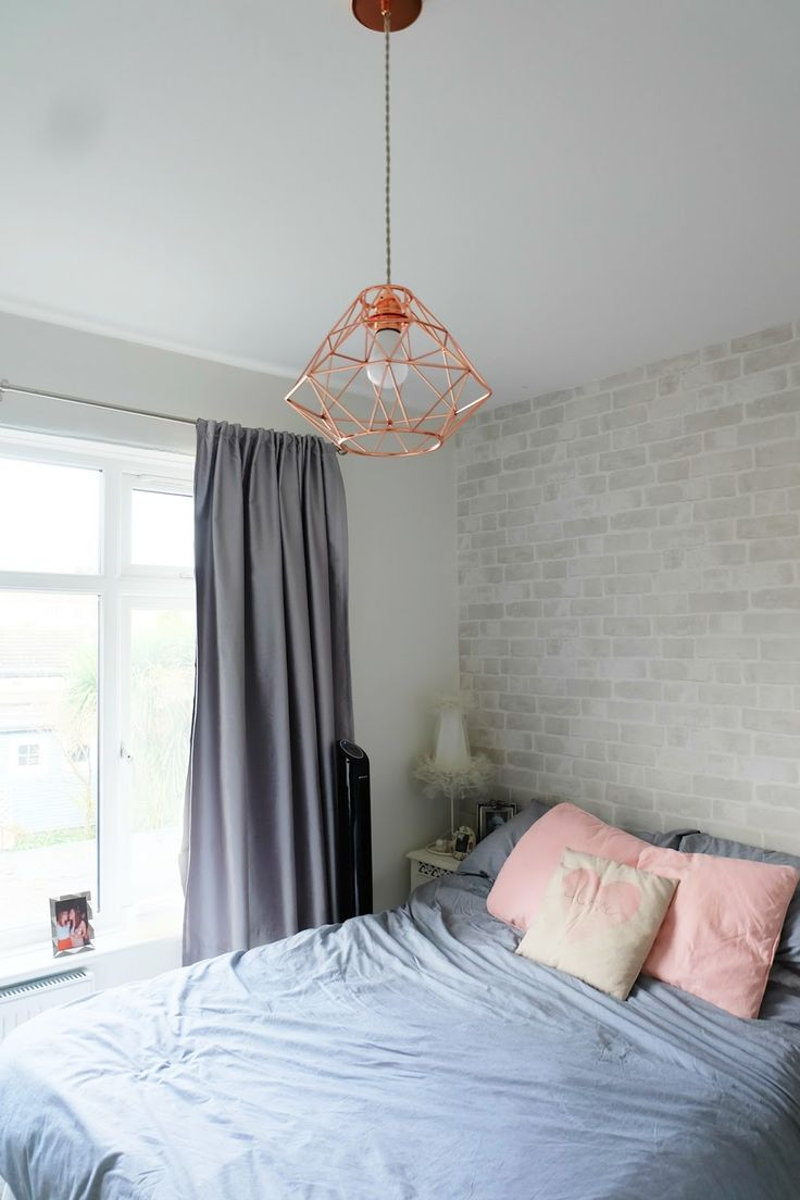 - wall inspo: white/gray brick wallpaper accent at head of bed wall (and opposite wall) next to bare white walls