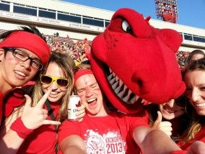 Flinders student Chris takes Selfies with the Calgary Dinos Mascot & friends while on exchange at the University of Calgary, Canada