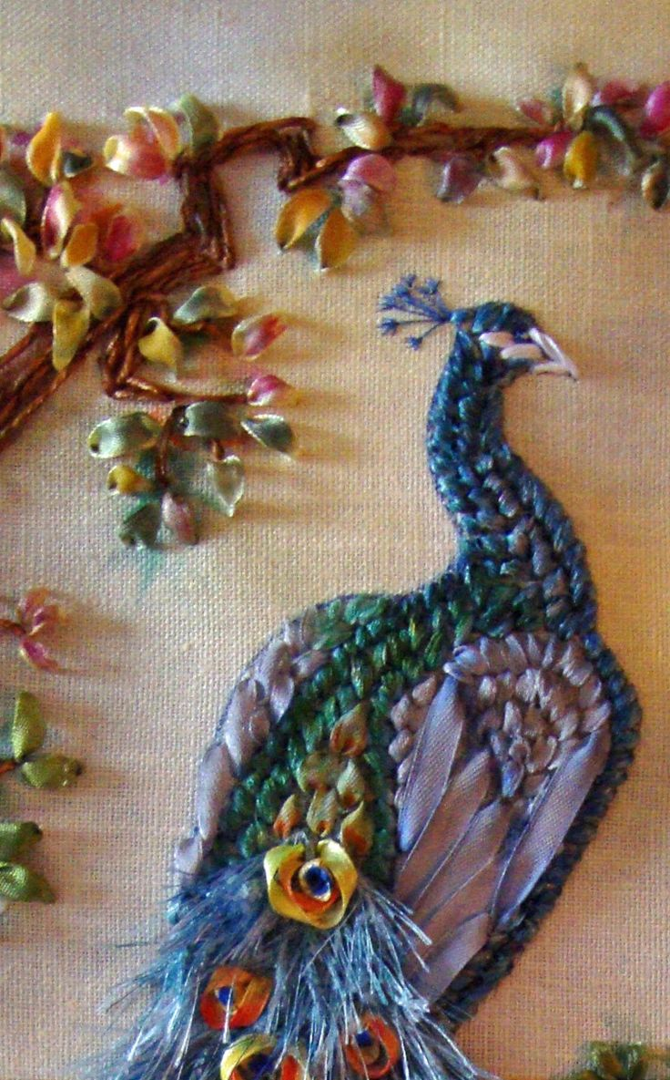 Peacock embroidery.  Not going to make this, but it reminds me of a large picture that my grandparents had.  Was it made with beans?