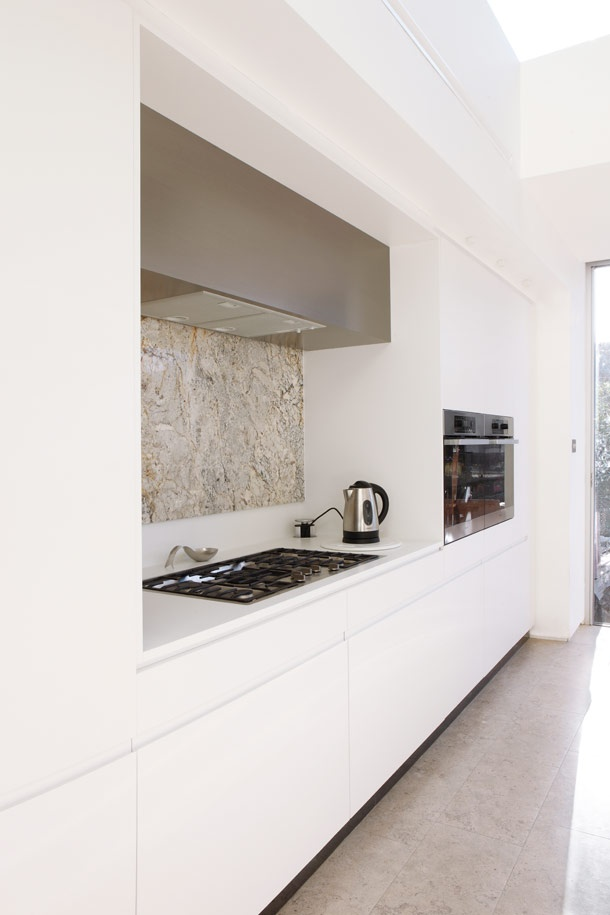INTERIOR-iD kitchen project with MWAI Architects: White matt lacquer, Kashmir white granite worktop and splashback.