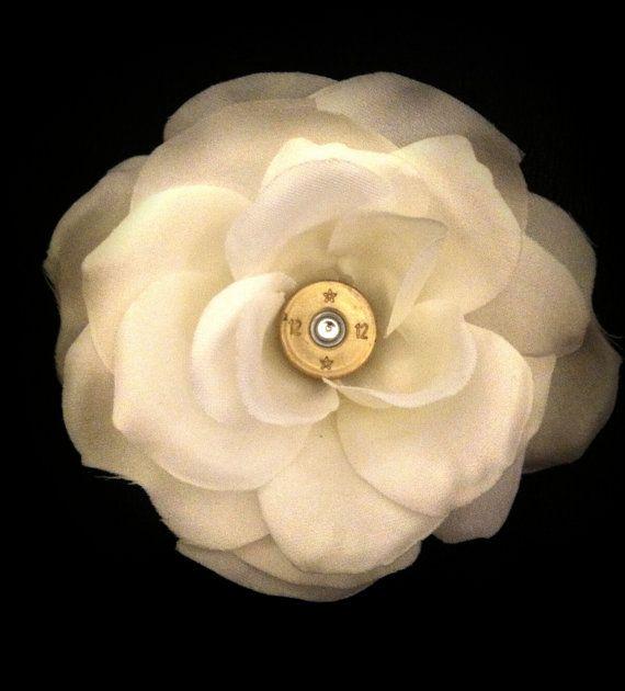 12 gauge shotgun shell inside white magnolia hair flower #love