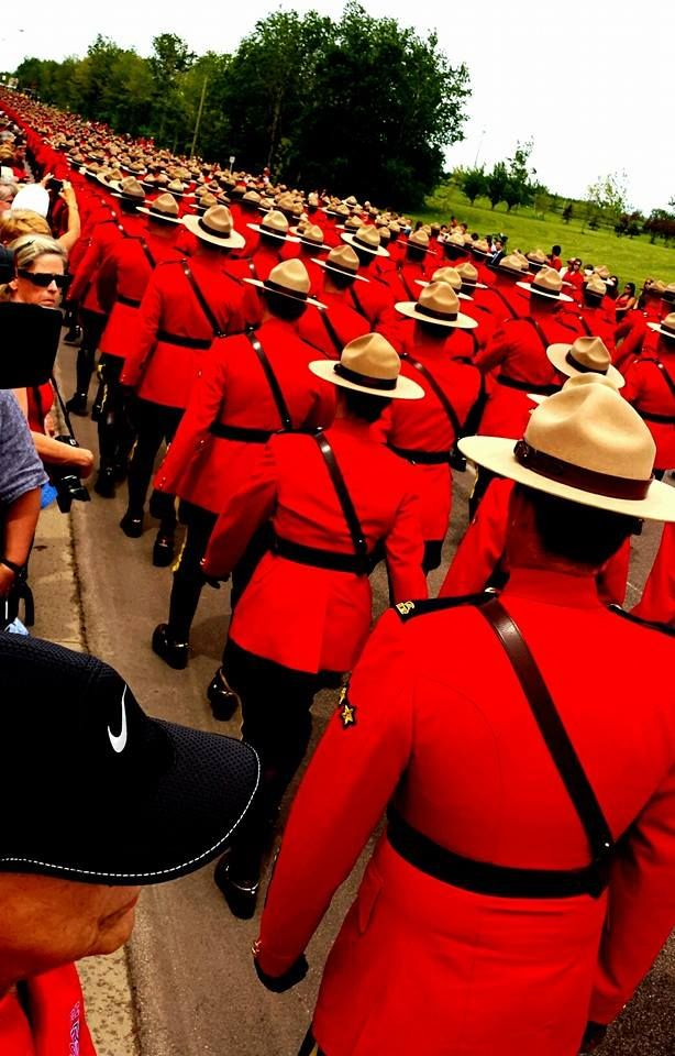 Royal Canadian Mounted Police at the funeral for three of their own in Moncton, New Brunswick June 10,2014