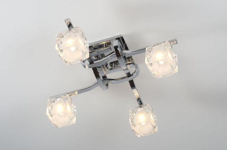 A truly modern ceiling flush light fitting. The distinctive clear glass shades with frosted interior to diffuse the light have indentations to add interest. . A lovely design feature of this fitting is the cleverly interwoven polished chrome arms. A great fixture to brighten up a low ceilinged dark room! http://www.styleandlight.com/ludo-cross-chrome-ceiling-light