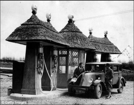 Staff wore oriental robes at the 'Chinese garage' in Beckenham, Kent. old pump. Blashford, Hampshire, 1930, Renault Type NN Town Car