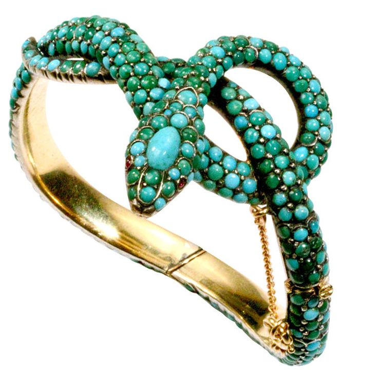 19th century French snake bangle with cabochon turquoise beads and little rubies for eyes.  FANTASTIC!