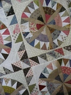 Lovely geometric block -- hand pieced -- a modern heirloom. I've pinned it with the traditional quilts because it fits here best.