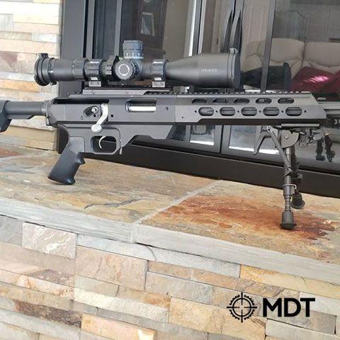 Remington 700 action  MDT TAC21 Chassis  Timney Calvin Elite