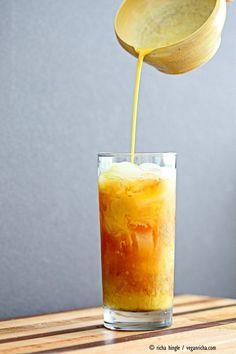 Cardamom Cinnamon Turmeric Iced Tea. Spiced Iced tea like Thai Iced tea with turmeric coconut milk and Indian masala chai spices and ginger. Golden Milk Iced Tea. Vegan Gluten-free Soy-free Recipe | VeganRicha.com