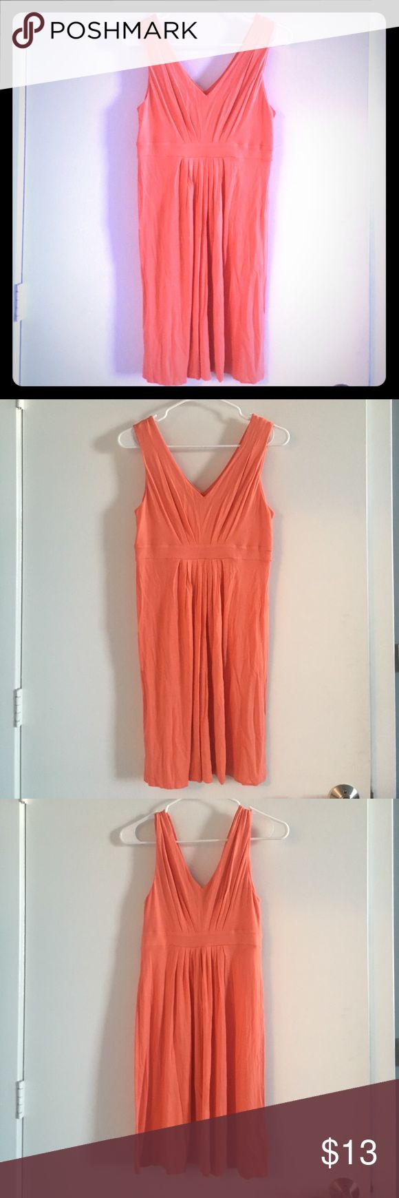 "Ann Taylor LOFT coral sundress XS LOFT XS sundress. Pinkish orange peach/ salmon/ coral color. Very comfy especially on a hot day. Good used condition. I am 5'2"" and it hits just above my knee. Tons of life left- a tiny bit of pilling but nothing noticeable. Empire waist with very forgiving breezy skirt. LOFT Dresses"