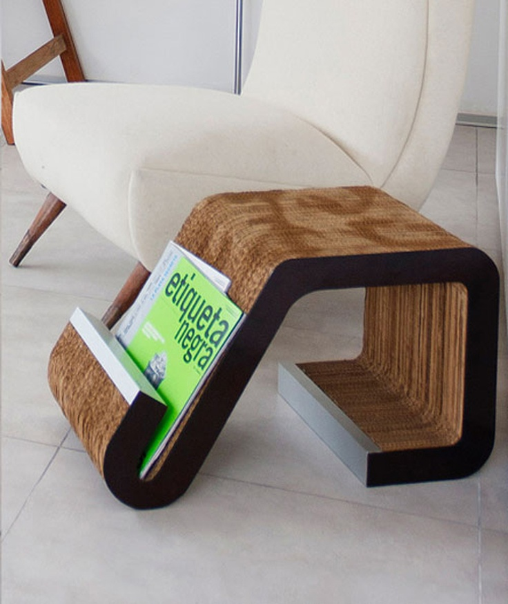 Sweet. This magazine holder is made of cardboard, aluminum and wood by by Peru-based design firm Oneto/Sousa Arquitectura Interior. I CAN SO MAKE THIS