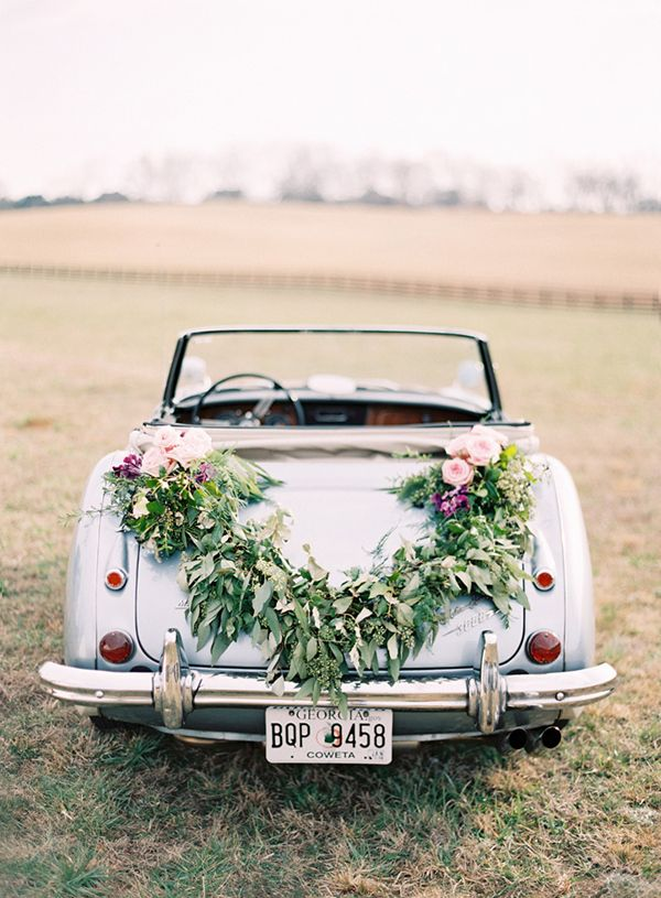 gorgeous getaway wedding car