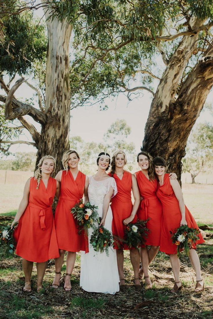 red bridesmaid dresses // I don't like this shade of red, but I like the idea