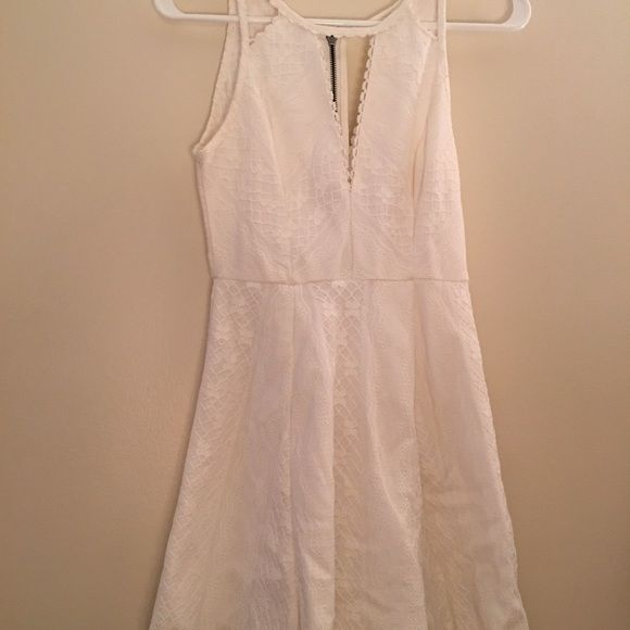 Free people white dress White dress only worn once! Dipper in the back . SIZE SMALL ON TAG Free People Dresses