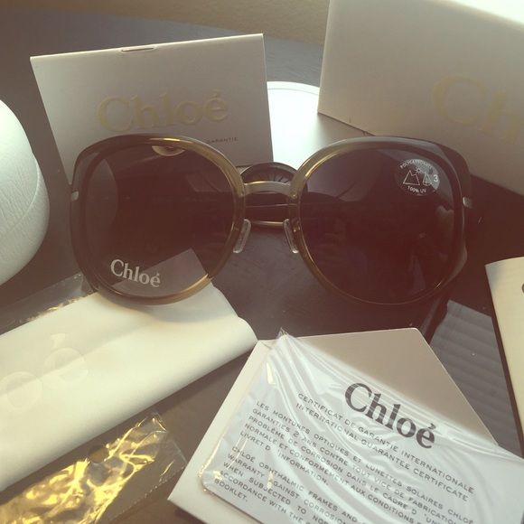 Chloe Sunnies BNWT Perfect year- round sunglasses from the iconic brand Chloe: brand new with tags- comes with authentication certificate, 2-year manufacturer warranty, cleaning cloth, care booklet, hardcase, and gift box. Will update pictures if needed with better lighting!  Black round lenses with light gold sheer tint around nose bridge. Discret silver Chloe stamped logos on each leg. Made in France. 100% UV protection. ✈️ Chloe Accessories Sunglasses