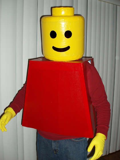"$7.00 DIY Lego Costume. This was great inspiration. I am a ""mom on the go"" though, so I didn't have time or patience for the perfection this how to called for. Mon's Tip:  Paper mache' a small propane tank. (Cover it in Saran wrap first though) Sand Paper Mache' as needed,  cut out holes and paint. Used Black Panty hose for the eye and mouth holes. Only cost is for paint, and newspaper."