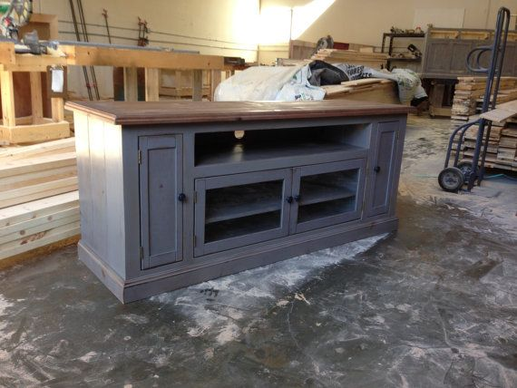 This is very similar to ours, however ours has a fully painted top, and 3 glass doors instead of the side doors. It's a grey/periwinkle color with copper handles on the doors. TV Stand Entertainment Center Media Console by VintageMillWerks