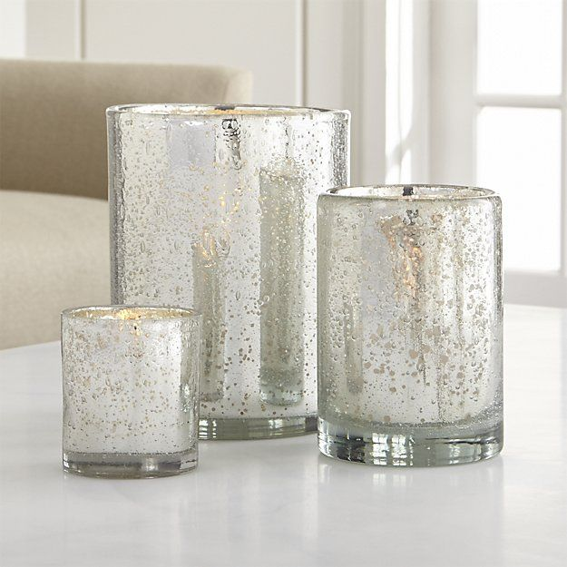 This handcrafted bubbled glass votive glimmers with the silvery look of antique mercury glass. This classic accent to the holiday table also makes a great gift.