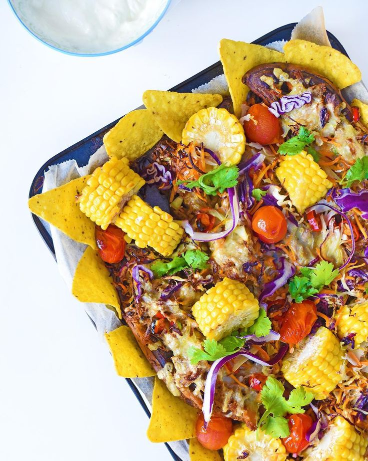 A fun Saturday night family dinner: colourful, tasty and healthy Sweet Potato Nachos (pg 230 of @_sarahwilson_'s #simplicious). I did a giant family tray with #freezerstash pulled pork and we all tucked in. Loads of veggies, and just the right amount of cheese and chili. Of course, I saved the corn cobs to make corn cob stock, another Simplicious recipe (p 43).