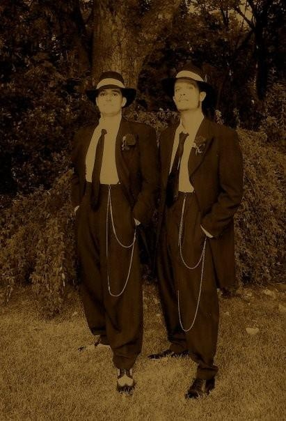 Killer Dillers wore this silhouette in  1940, it was called the zoot suit. They also wore pork pie hats .... Shacoya Trotter