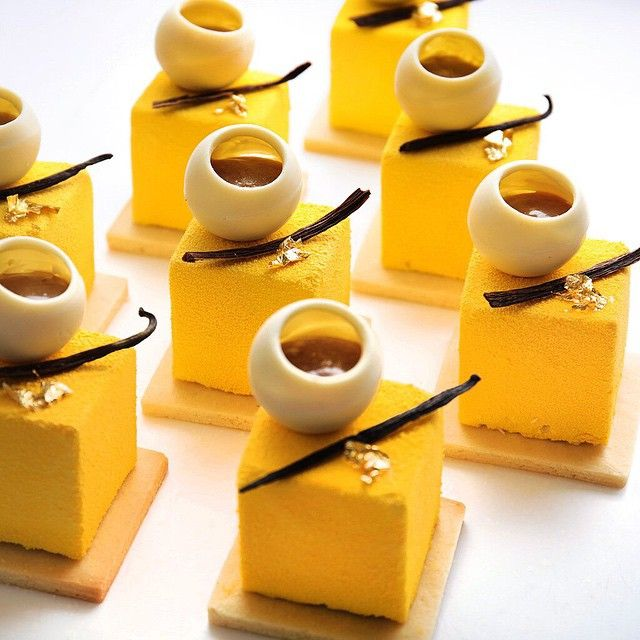 """Today cake menu """"Exotic cheesecake."""" Mousse with philadelphia, apricot marmalade, passion fruit, coconut biscuits, shortbread dough, white chocolate and banana"""