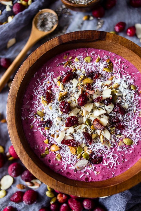 This cranberry smoothie bowl is packed full of cranberries, mixed berries, bananas, almond milk and topped with coconut, chia seeds and nuts. It's healthy, delicious and the perfect holiday rush breakfast.
