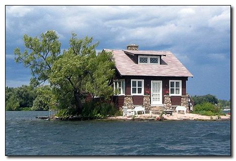 This house is cutely titled Just Room Enough. At first sight, it looks a picture taken 30 seconds before somebody died in a flood, but the structure is actually built on an island exactly the size of the house. Located between Canada and America on the St. Lawrence River, Just Room Enough was bought by the Sizeland family in the 1950s. They purchased the little parcel of land in the hopes of having somewhere to go to to get away from the hustle and bustle of everyday life, and they figured…