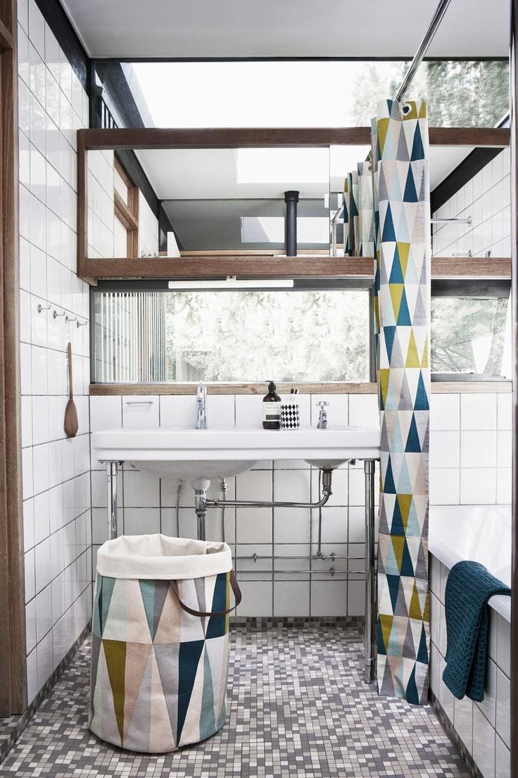 geometric shower curtain, amazing windows, black grout, gray mosaic tile
