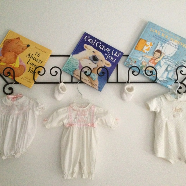 New use for a plate rack. Keep the memory of your kids first or favorite outfit and book