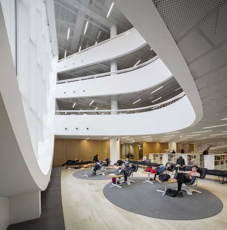 Designed by newcomer architects Anttinen Oiva, Helsinki University's new main library - the largest academic library in Finland - is wedged inbetween dense city blocks in downtown Helsinki.