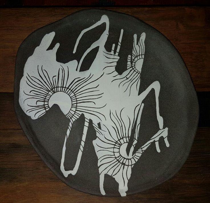 African Daisy: white underglaze sgraffito on black clay