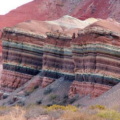 Linear horizontal sendimentary rock formations with extreme variation in colour. SIREWALL could look like this