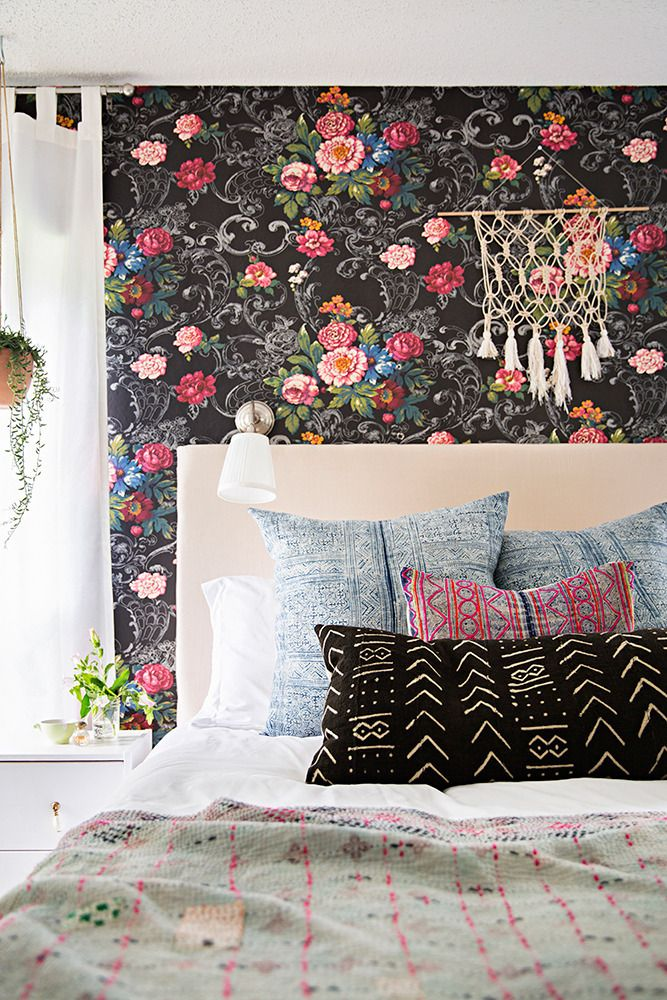Use a bold wallpaper to add character and warmth to a room. This amazing floral brings the room together.