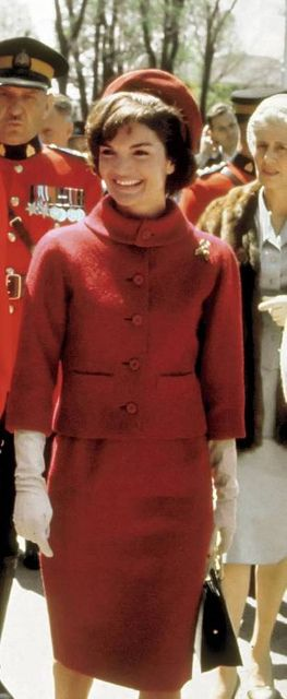 Jacqueline Kennedy wearing a red wool suit for the first official state visit to Canada, 1961
