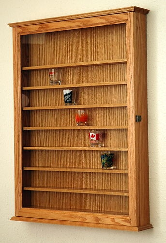 Tad likes this for his shotglass collection: 72 Oak Shot Glass Display Case Wall Cabinet Shelf Rack   eBay