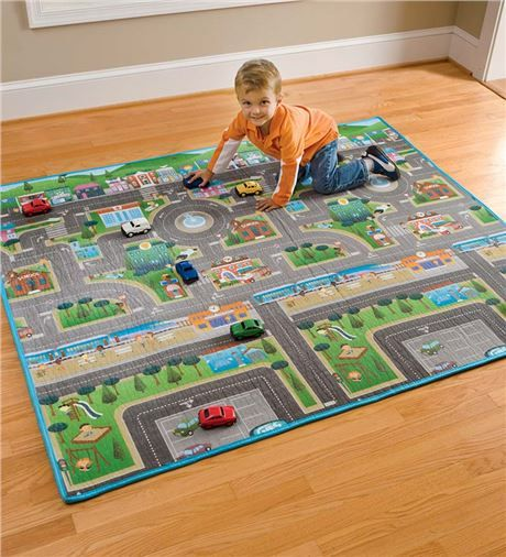 Reversible play mat...town on one side and countryside on the reverse. Folds up to put away...great for Grandma's house!