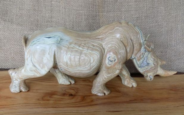 "Zimbabwean hand carved "" African Rhino "" from Savanna Jade ."
