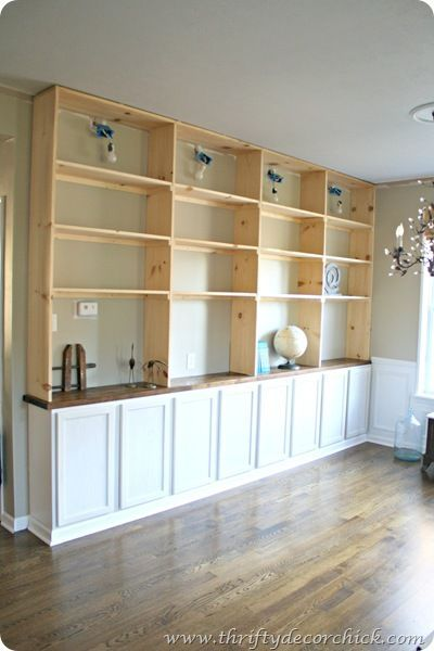 How to build a DIY bookcase - install kitchen cabinets then build shelves according to your personal needs