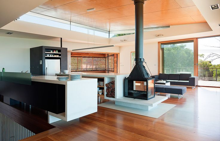 """Room with a View and a Cheminees Philippe 3 sided fireplace by David Seeley Architects """"Large south facing windows and 5 energy ratings do not generally mix well."""" To address this the house is passively heated and cooled"""""""