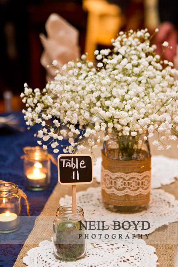 Baby's Breath wedding flowers for centerpieces.  Twine and lace with baby's bretah wedding flowers.